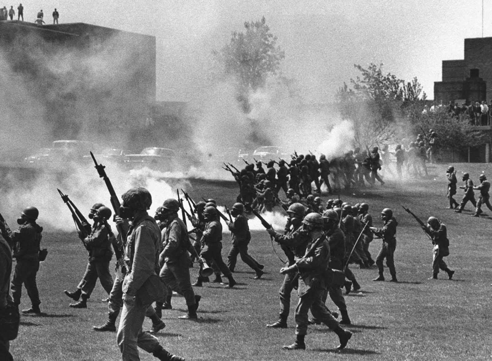 The Ohio National Guard moves in on rioting students at Kent State University in Kent, Ohio, on May 4, 1970. Four persons were killed and eleven wounded when National Guardsmen opened fire.