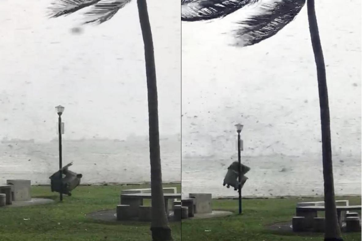 Screengrabs from a video showing a large dumpster being flung by strong winds at East Coast Park.