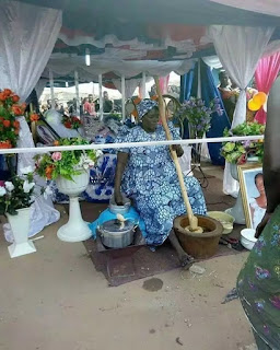 Dead Woman Pounds Yam During Her Lying-in-state In Ghana (Photo)
