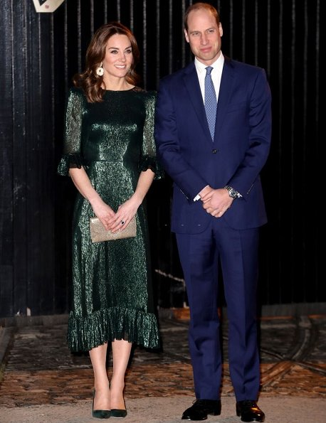 Kate Middleton wore The Vampire's Wife Falconetti emerald midi dress, Brora gold charm earrings. Meghan Markle