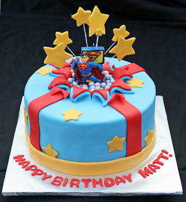 Superman Bursting Out of the Birthday Cake