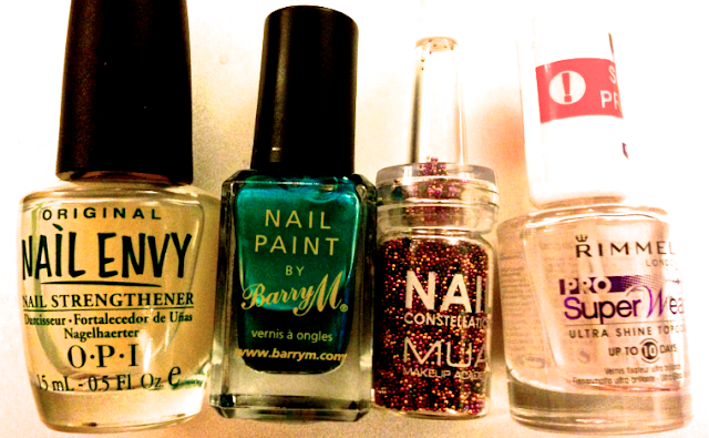 A picture of Opi's Nail Envy, Nail paint by Barry M, Nail constellations and Rimmel pro super wear.
