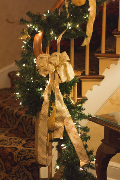 The large bows add elegance to the venue's staircase.