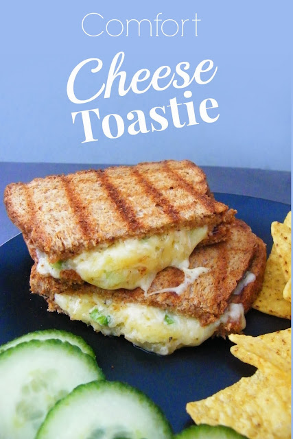 Oozy Comfort Cheese Toastie cut in half and stacked on black plate