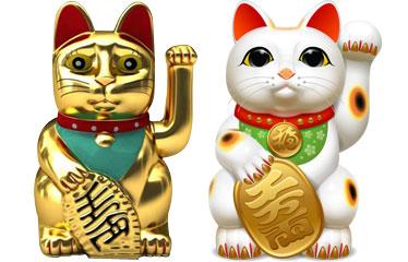 Figuras del gato de la suerte dorado y blanco con manchas