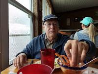 man eating shrimp