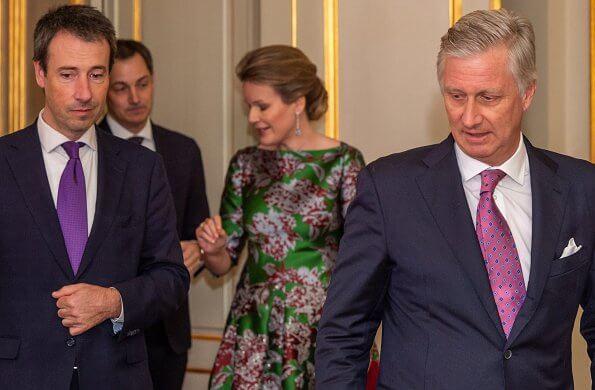 Queen Mathilde wore a green floral-print satin dress by Natan. Édouard, baron Vermeulen is a Belgian fashion designer. Natan red suede pumps