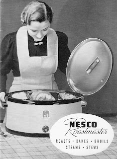 Woman viewing contents of vintage Nesco Roastmaster electric roaster