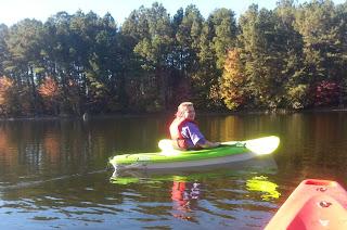 Girl in plastic kayak
