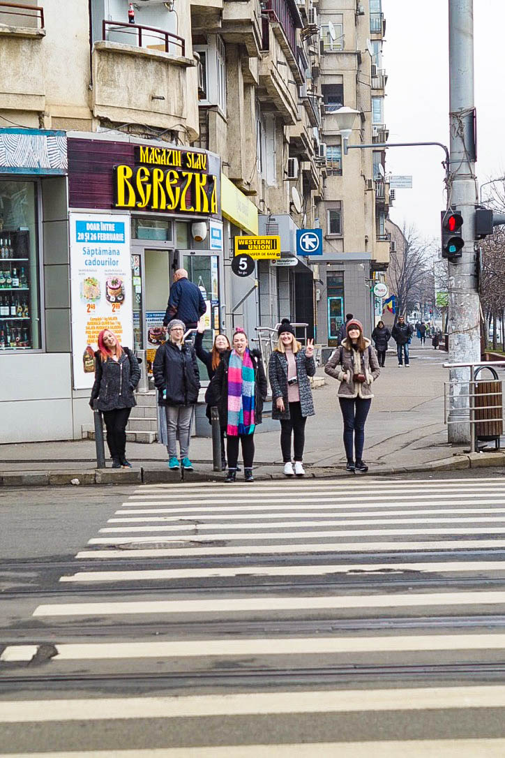 Women waiting to cross zebra crossing