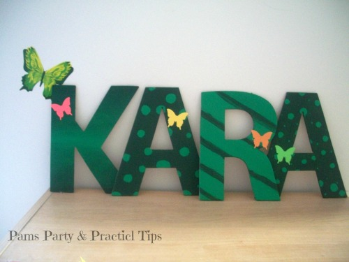 Decorated name sign for a butterfly party at Pams Party and Practical TIps