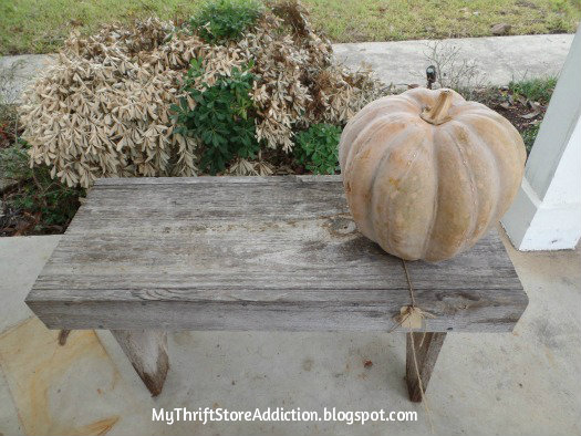Smitten! mythriftstoreaddiction.blogspot.com Bench and faux cement pumpkin on front porch