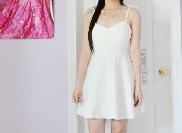Be an angel in this all-white angel wing embroidered flared skater dress from Romwe, paired with spiked white Jeffrey Campbell Lita dupe platform booties.