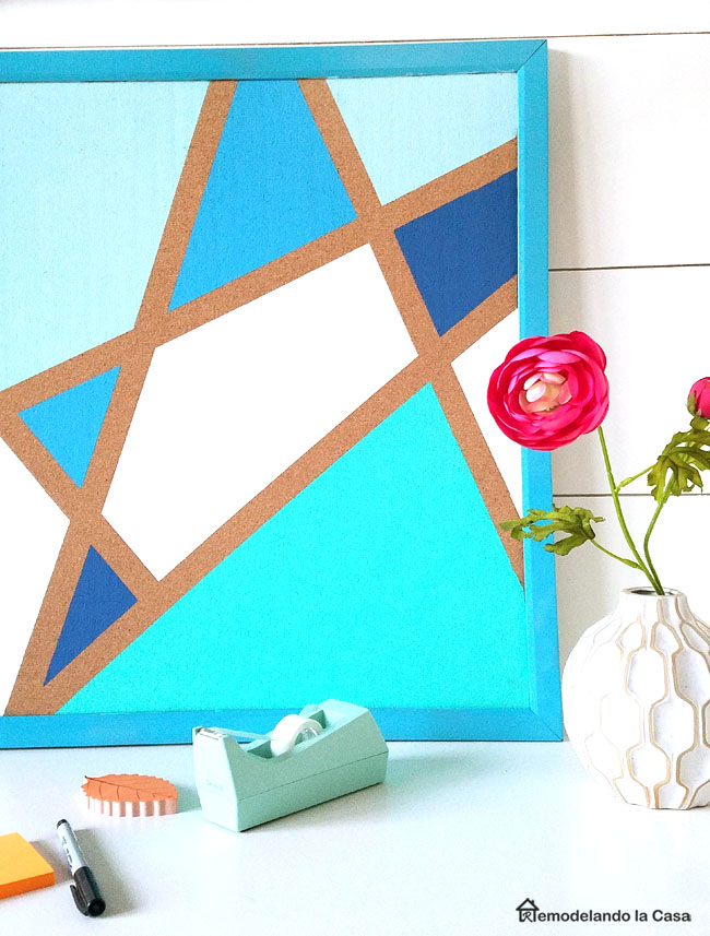 painted blue geometric figures on cork board