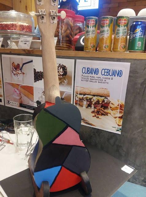 Deah's painted ukulele at UkeHUB Kafe