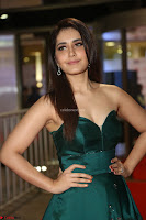 Raashi Khanna in Dark Green Sleeveless Strapless Deep neck Gown at 64th Jio Filmfare Awards South ~  Exclusive 114.JPG