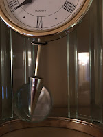 photo of swinging clock pendulum
