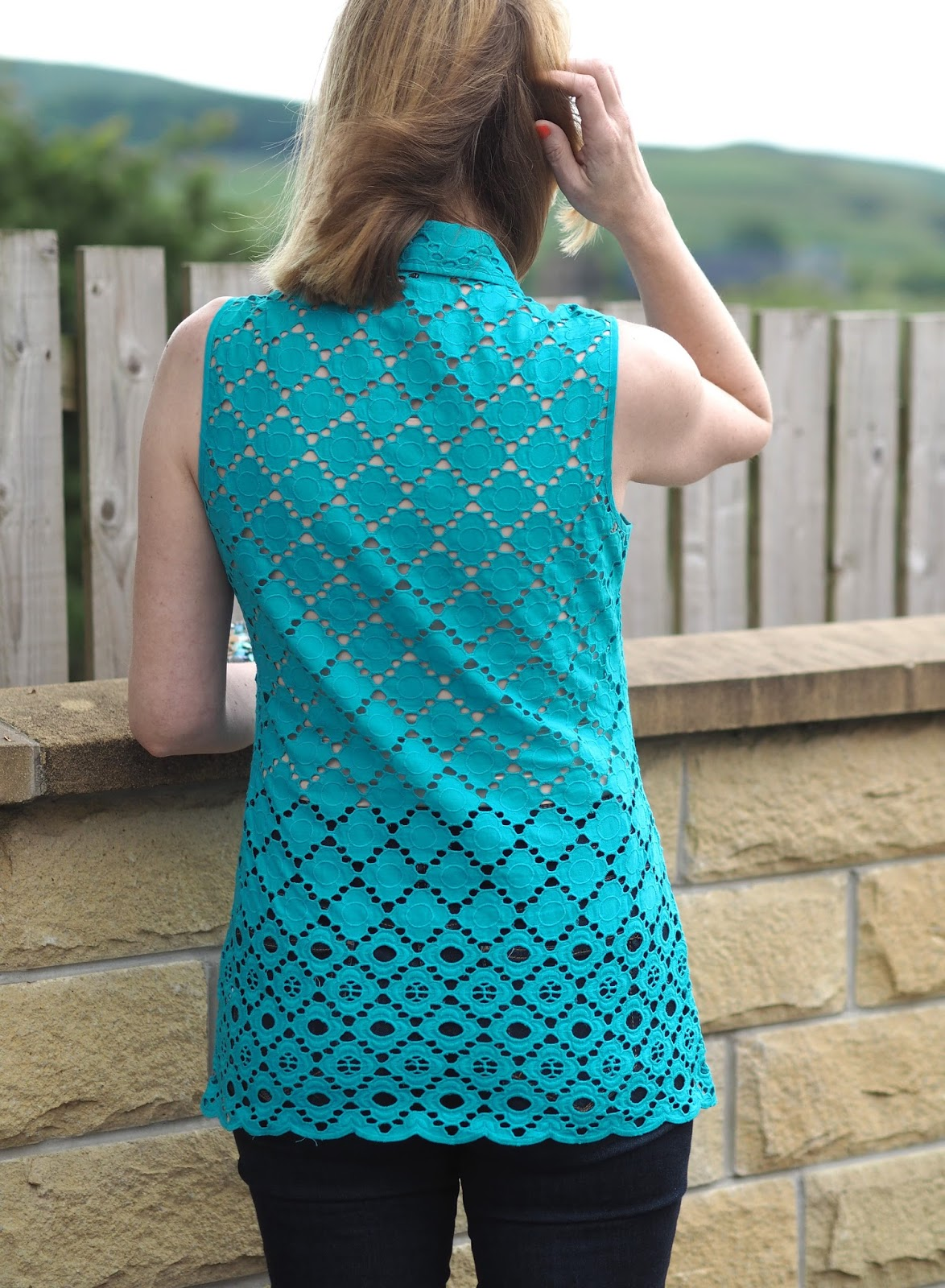 Turquoise broderie anglais top with skinny jeans