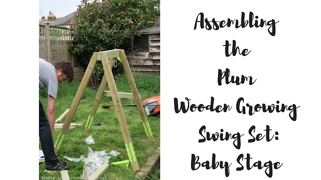 Rob assembling the Plum Wooden Growing Swing Set in the garden. Started with the baby stage first.