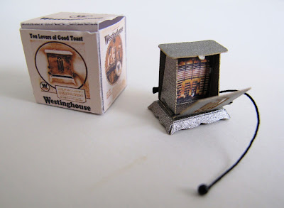 1/12-scale vintage toaster with drop-down sides, and a box for it.