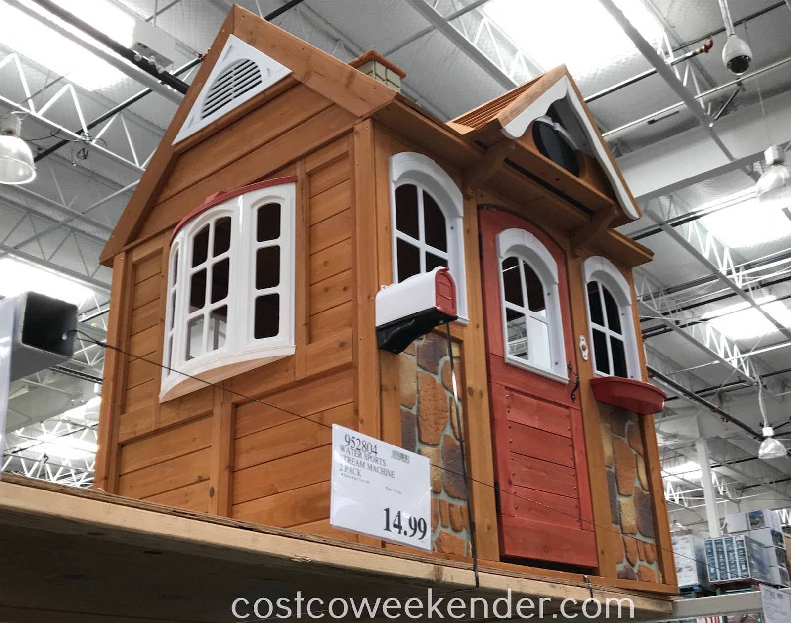 The kids will have fun in their own home with the Cedar Summit Stoneycreek Cedar Playhouse