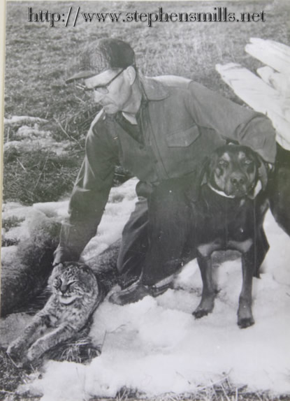 Photo of Alfred Jackson with his hunting dog and bobcats