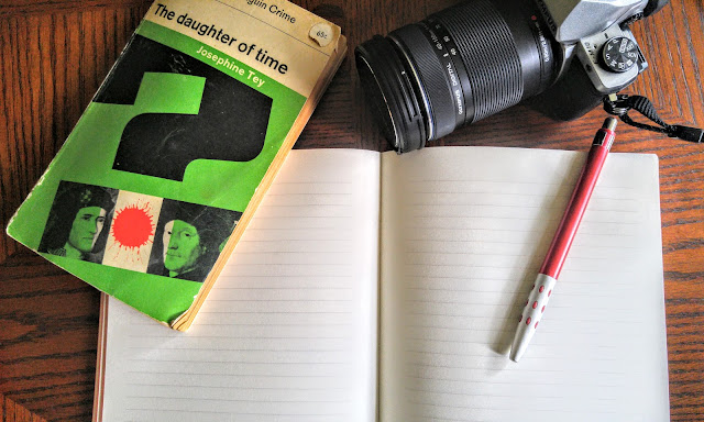 camera, book, and notebook