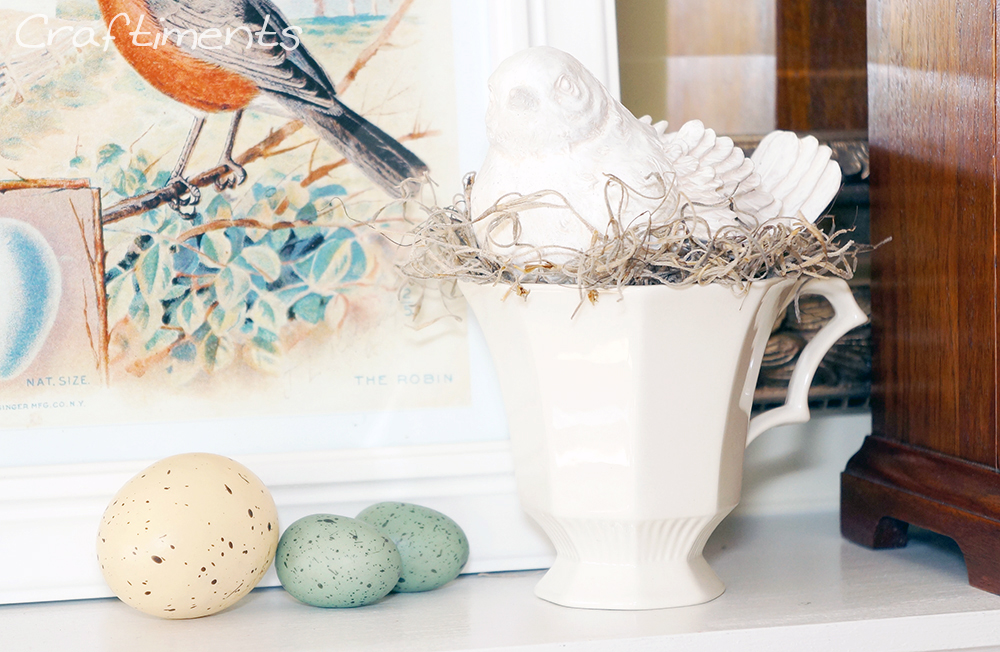 faux bird eggs and bird nesting in a teacup