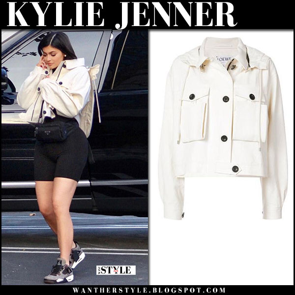 Kylie Jenner in white cropped jacket, black shorts and sneakers nike street fashion february 10