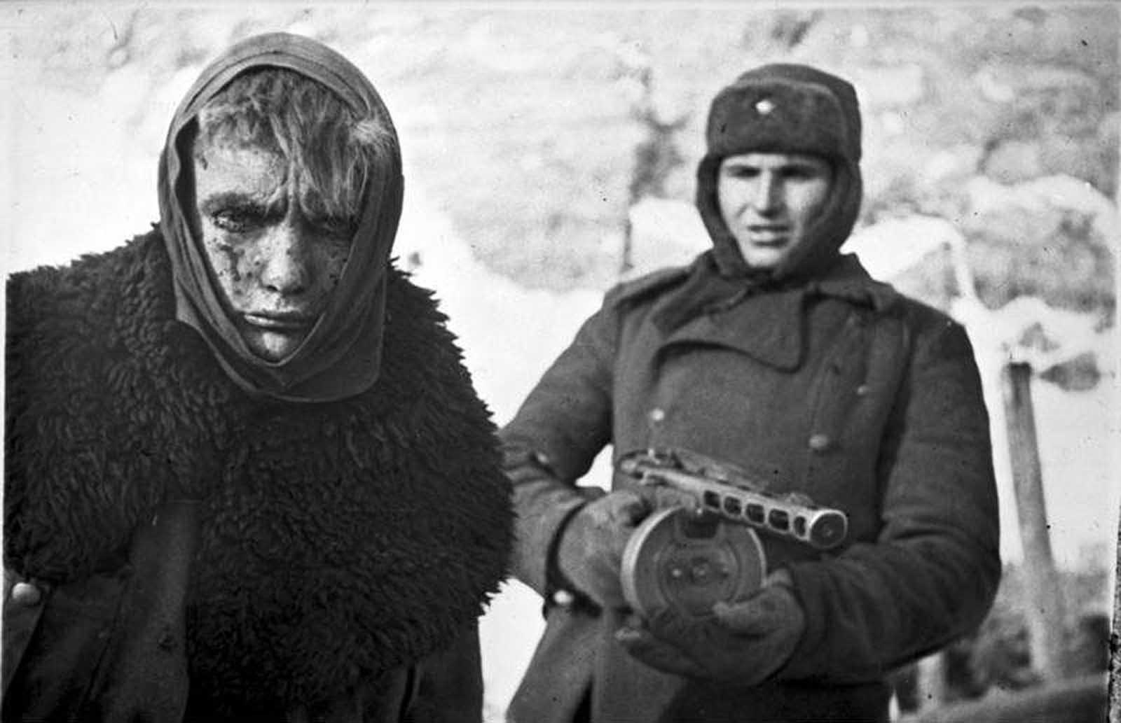 In February of 1943, a Soviet soldier stands guard behind a captured German soldier. Months after being encircled by the Soviets in Stalingrad, the remnants of the German Sixth Army surrendered, after fierce fighting and starvation had already claimed the lives of some 200,000.