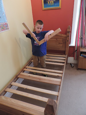 single wooden bed broken by kid jumping on it