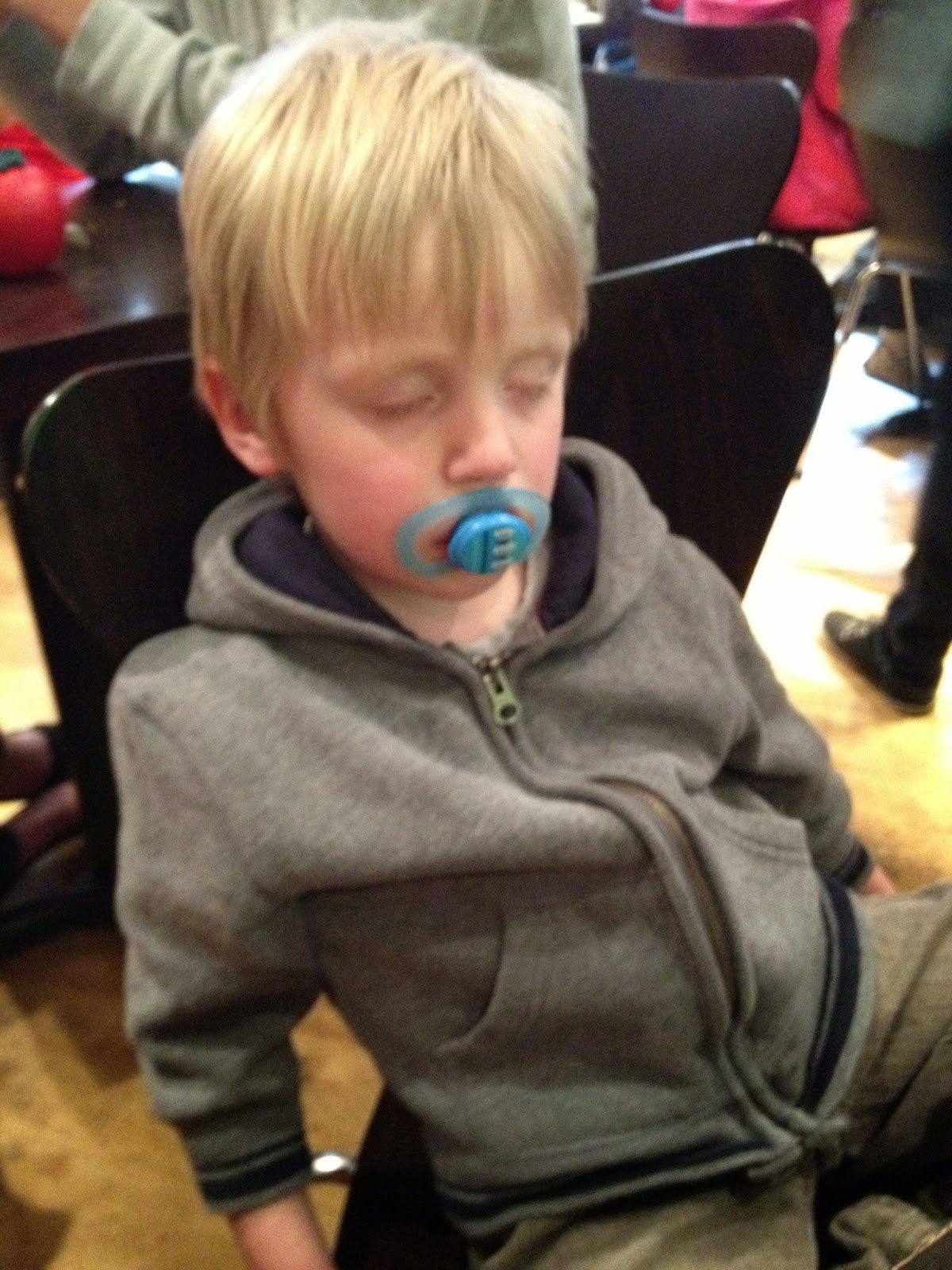 child asleep with dummy/soother