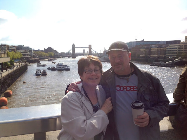 Holly and Pierre pose in front of London Bridge on a recent visit to the U.K.
