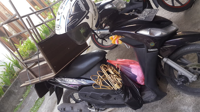 sorry motorbike, carry table and seat and other stuff, Bali , Indonesia