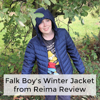 Boy standing in some trees wearing a Reima Falk Boys Jacket