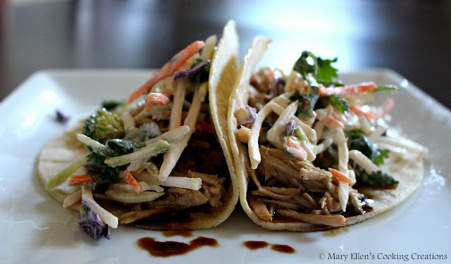 Korean Pulled Pork Tacos with a Creamy Sriracha slaw. Crock pot slow cooker cooking. Celebrating 10 years of our best recipes.