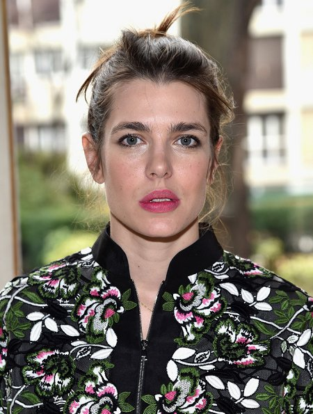 Charlotte Casiraghi at Paris Fashion Week show. Charlotte Casiraghi wore Giambattista Valli Macramé Lace Bomber Jacket and carried Giambattista Valli bags