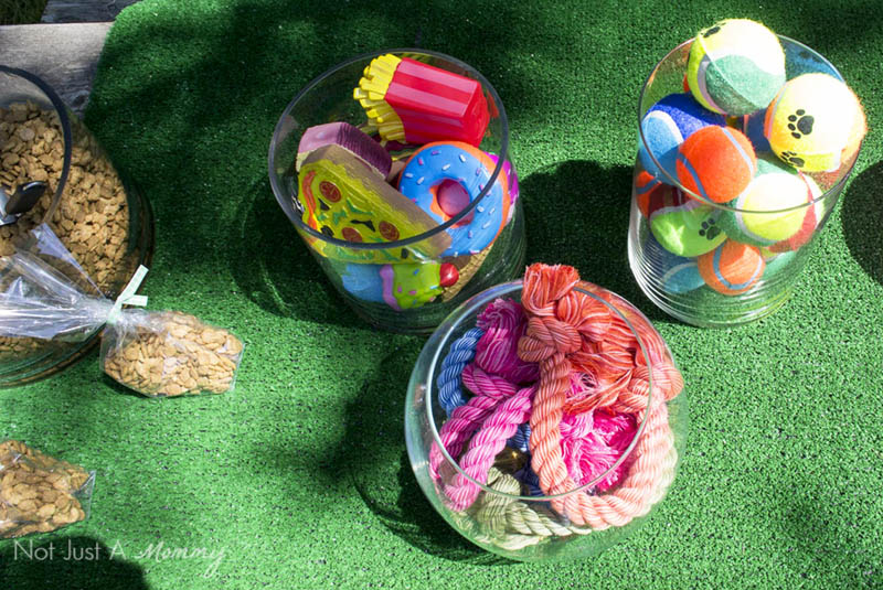10 Tips For Hosting Your Dog's Barkday Party; doggy toys table