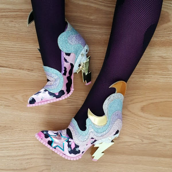 legs on floor showing lower side of leopard print shoe and higher side of boot with cloud and crescent moon detail and lightning bolt heels