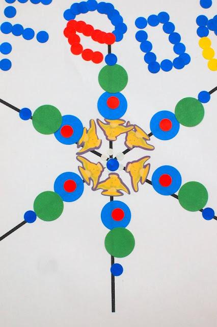Groovy Sticker Snowflake Art- Fun Winter Art Project for Kids
