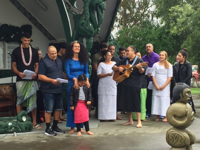 Selina's brother Luka Crosbie (on guitar) leads the family in a waiata for Selina.