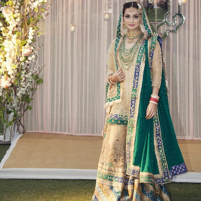 ritu kumar has designed a traditional joda for dia mirza's wedding. the style dates back to the mughal era and is contemporized in style but in essence has kept the embroidery traditon of the old zardozi craftsmanship.the ensemble is made up of a kurta, farshi paijama and a dupatta. the upper half or paat of the paijama is made of gold net and lined with tanchoi silk brocade and the lower half or gote is made of green and turq stripes of patched silk sewn together diagonally. each stripe is designed with stylized floral designs. the elaborate borders placed on both the paat and the gote seams are finished in a style typical of the hyderabadi court, a city which dia has lived in for many years. the dupatta has been embroidered by master craftsmen with a lineage from the avadh court. the kurta is decorated with zardozi around the neckline. a similar design is embroidered on the ground of the second emerald green dupatta in alternate rows of curling vines and stylized floral motifs. dia mirza,, Dia Mirza Wedding Photos with Sahil sangha