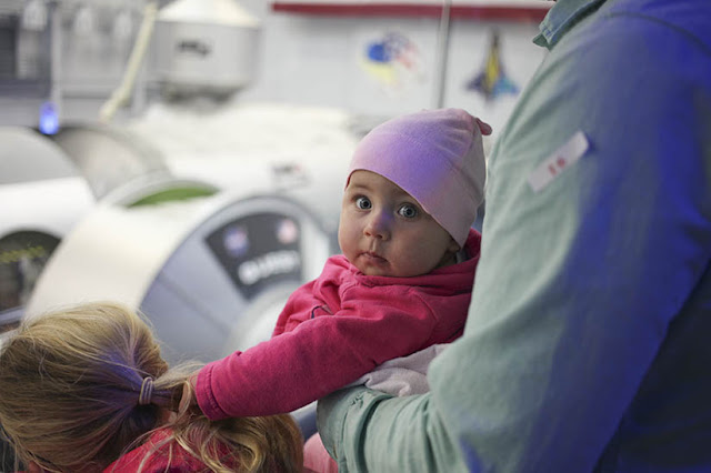 A family tours the astronaut training facility at the Johnson Space Center in Houston