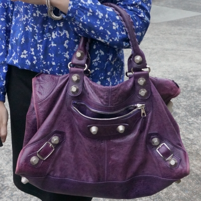 blue printed blouse accessorised with raisin purple Balenciaga SGH work bag slouchy   away from the blue