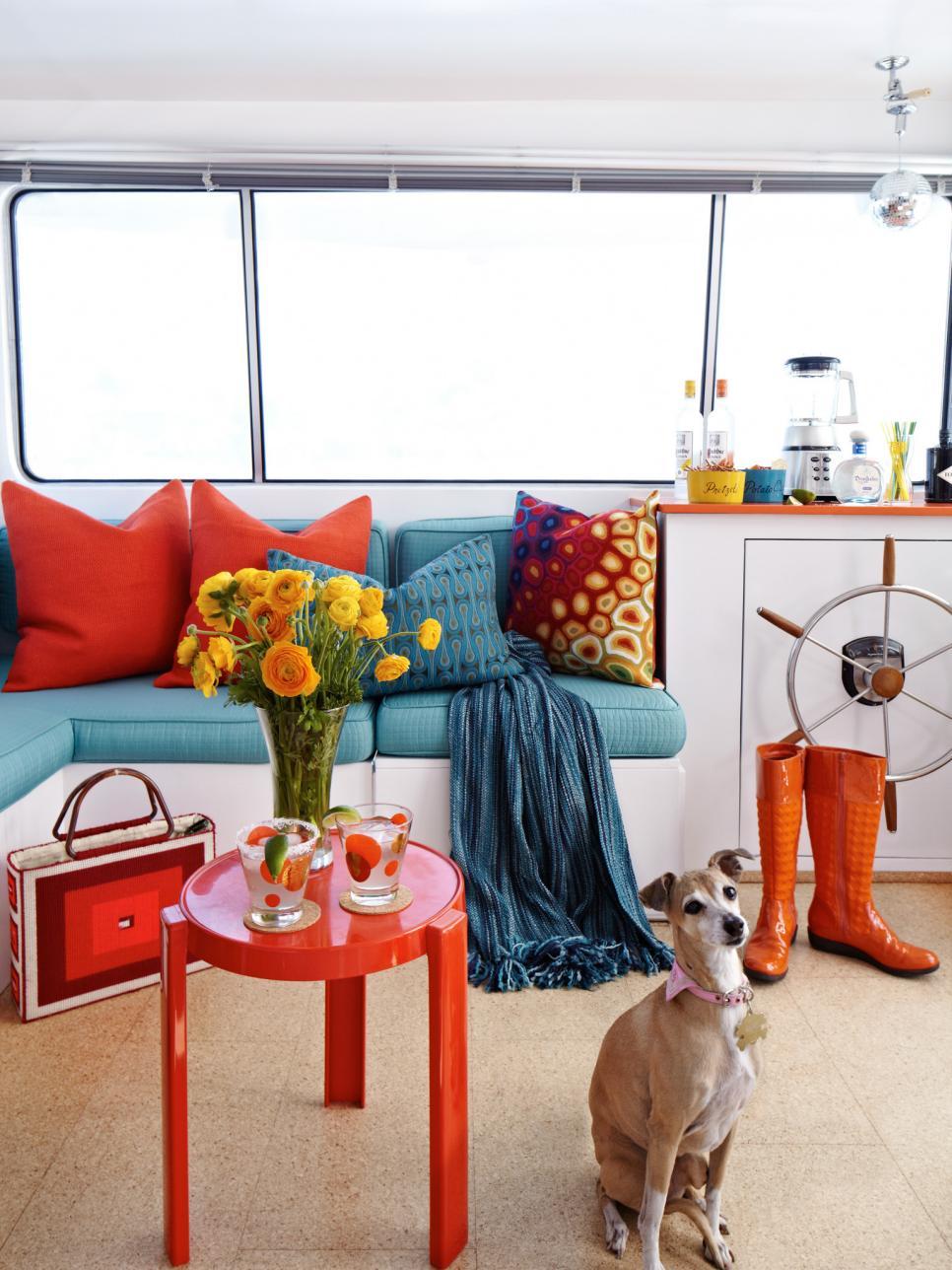 Colorful aqua and orange houseboat tour from HGTV | Sailboat Interior Decor