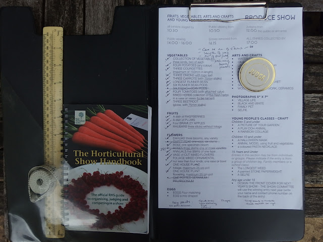 My judging kit - clipboard, show schedule, ruler, tape measure and handbook