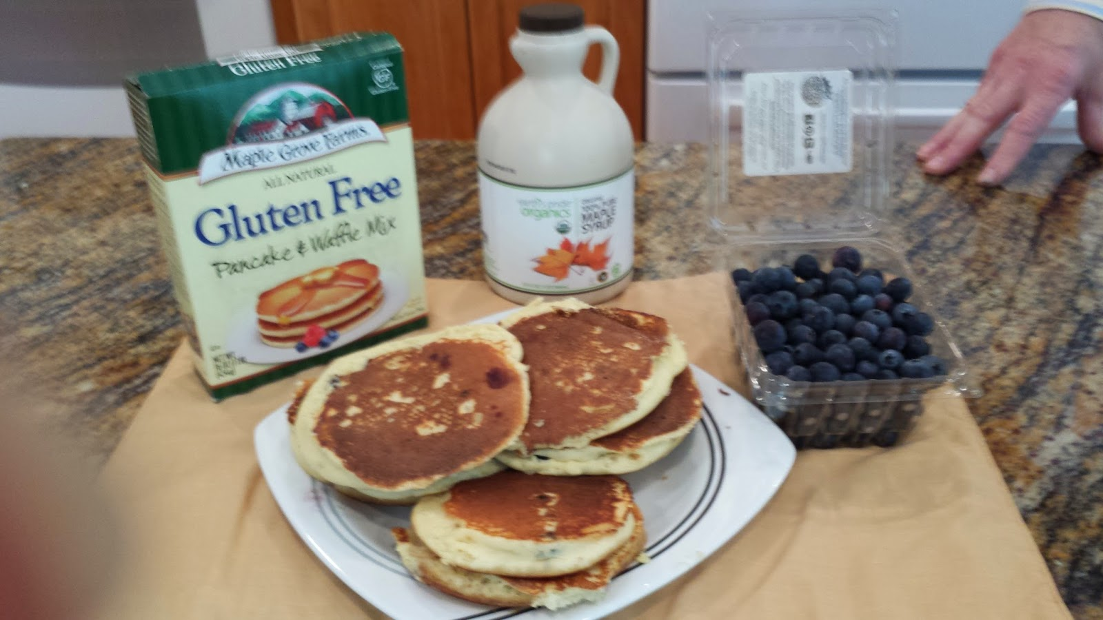 Gluten Free pancake mix and gluten free pancakes on a plate