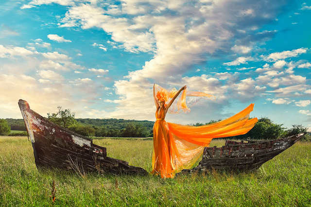 mystic magic, richard wakefield photography, photography, fantasy, photo shoot, summer, autumn, fashion, editorial, orange, dress, orange dress, couture, avant garde, high fashion, dreamy, magical, designer, millinery designer, creative makeup, shipwreck, boat, field,