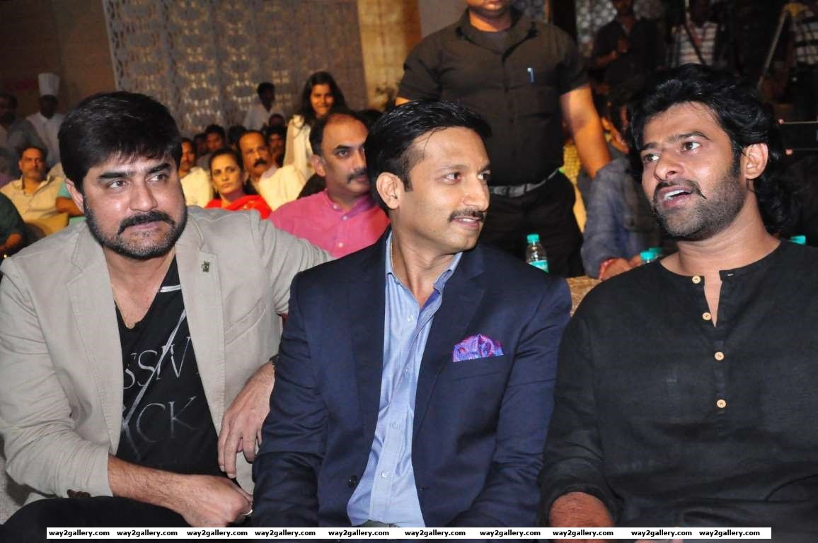 Gopichand in conversation with Prabhas during the launch of Well Care Health Card
