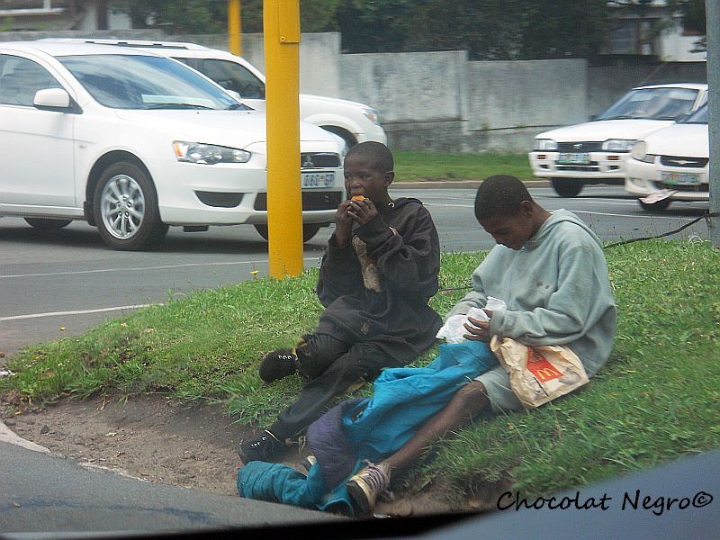 Children begging at a traffic light in East London, South Africa